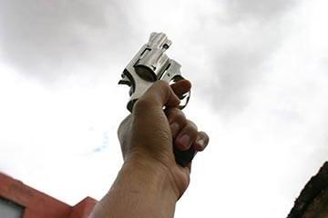 Soñar con Disparar